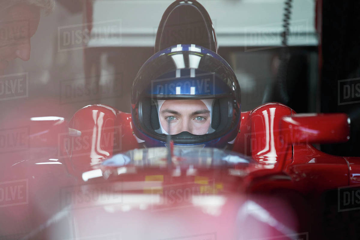 Focused formula one race car driver wearing helmet Royalty-free stock photo