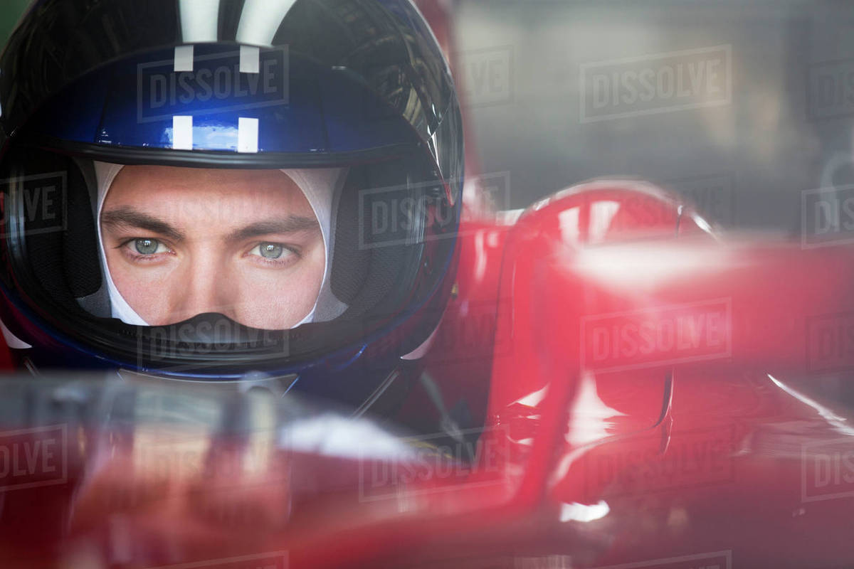 Close Up Focused Formula One Race Car Driver In Helmet Looking Away Stock Photo Dissolve