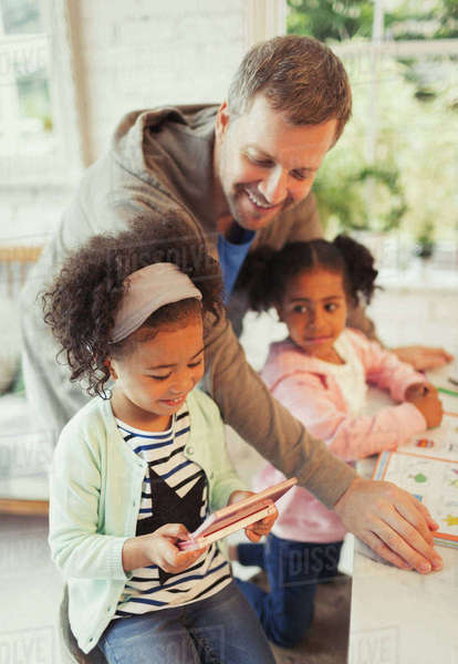 Multi-ethnic father and daughters with digital tablet Royalty-free stock photo