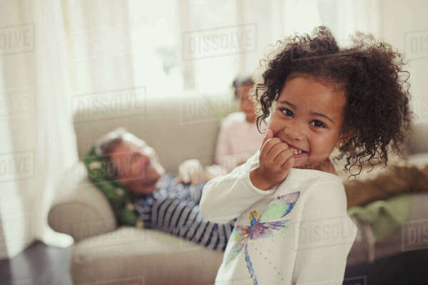 Portrait smiling, cute girl in living room Royalty-free stock photo