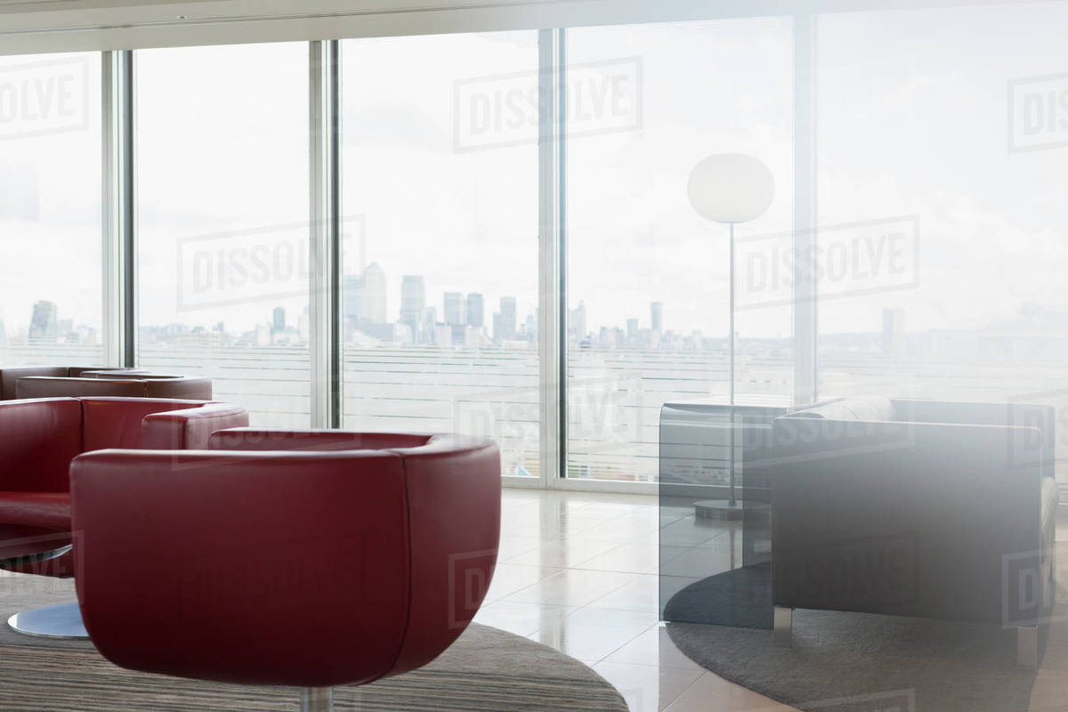 Leather Chairs And Sofa In Urban Modern Office Lounge With City View