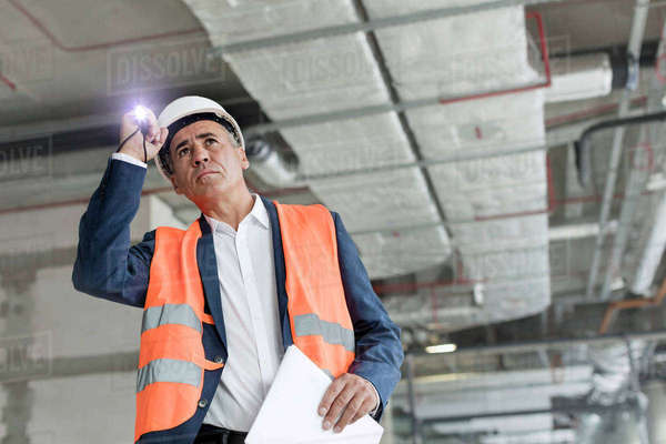 Foreman with flashlight at construction worker Royalty-free stock photo