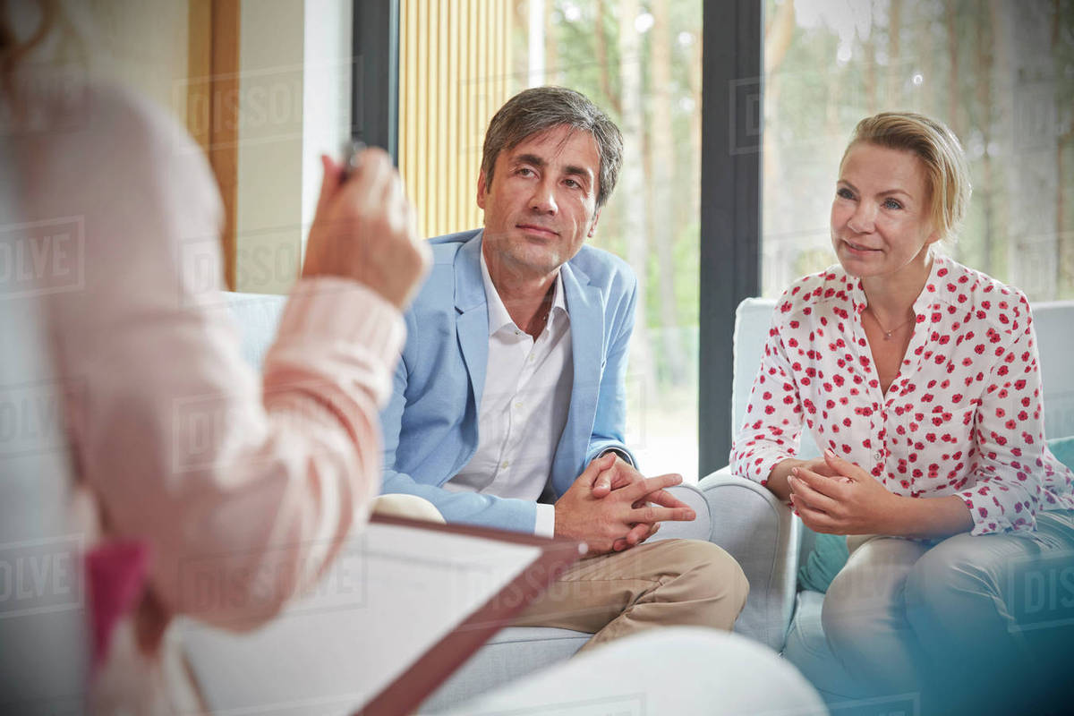 Couple Listening To Therapist In Couples Therapy Counseling Session