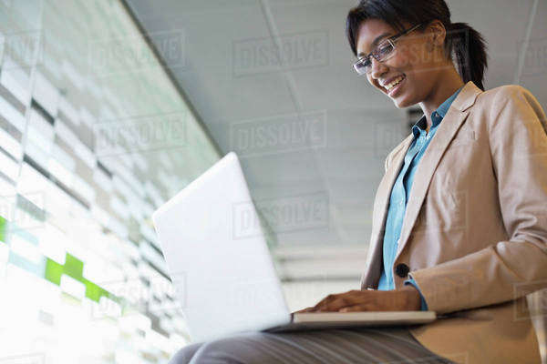 Businesswoman using laptop in office Royalty-free stock photo