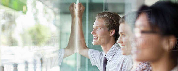 Business people looking out office window Royalty-free stock photo