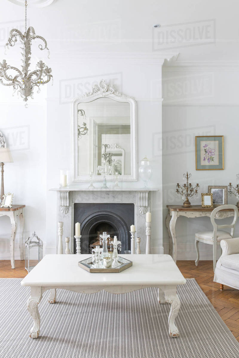 White, luxury home showcase interior living room with fireplace ...