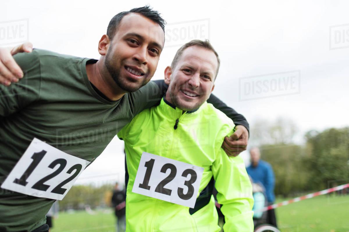 Portrait Smiling Male Marathon Runners Hugging