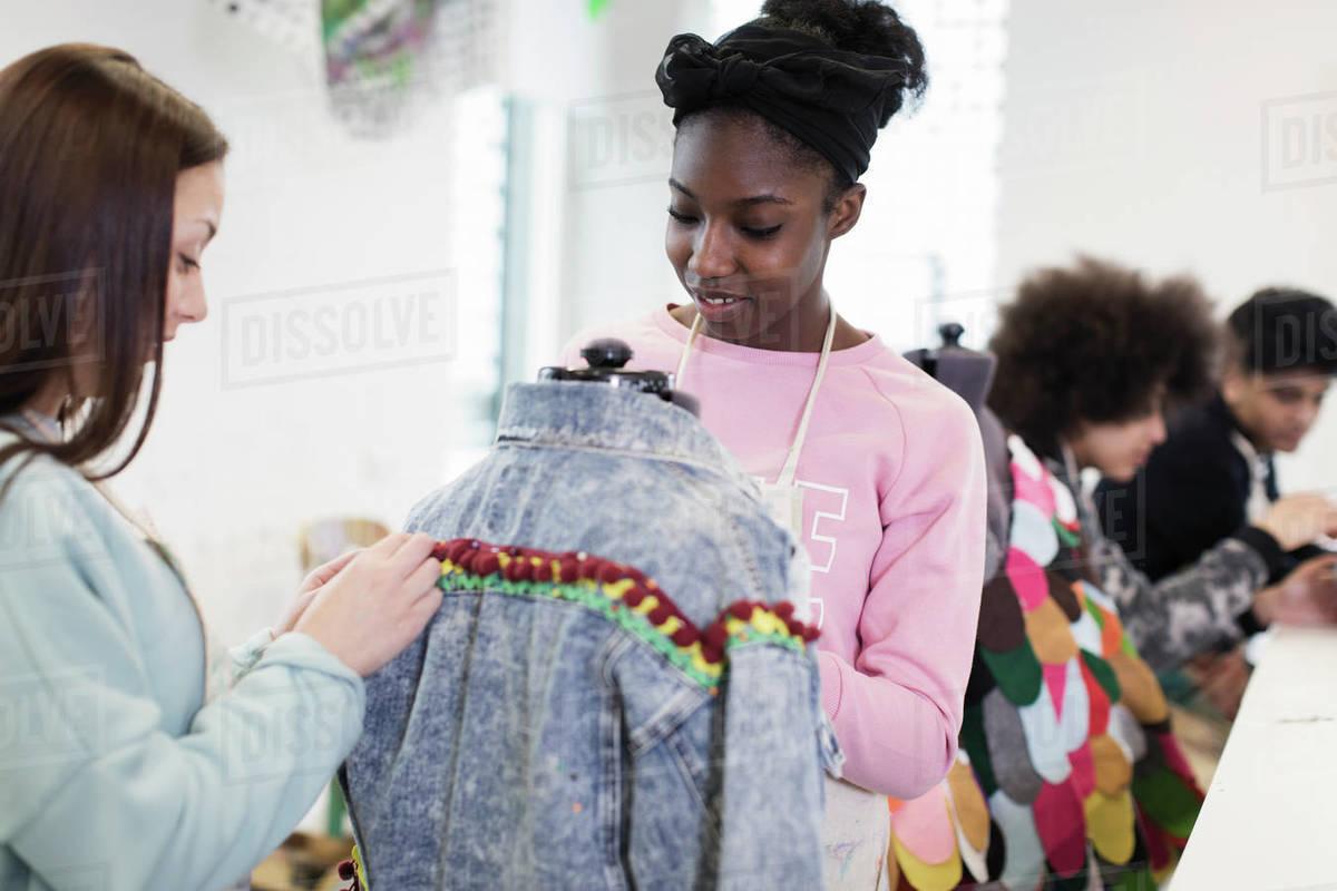 Teenage Girls Designing Denim Jacket In Fashion Design Class Stock Photo Dissolve