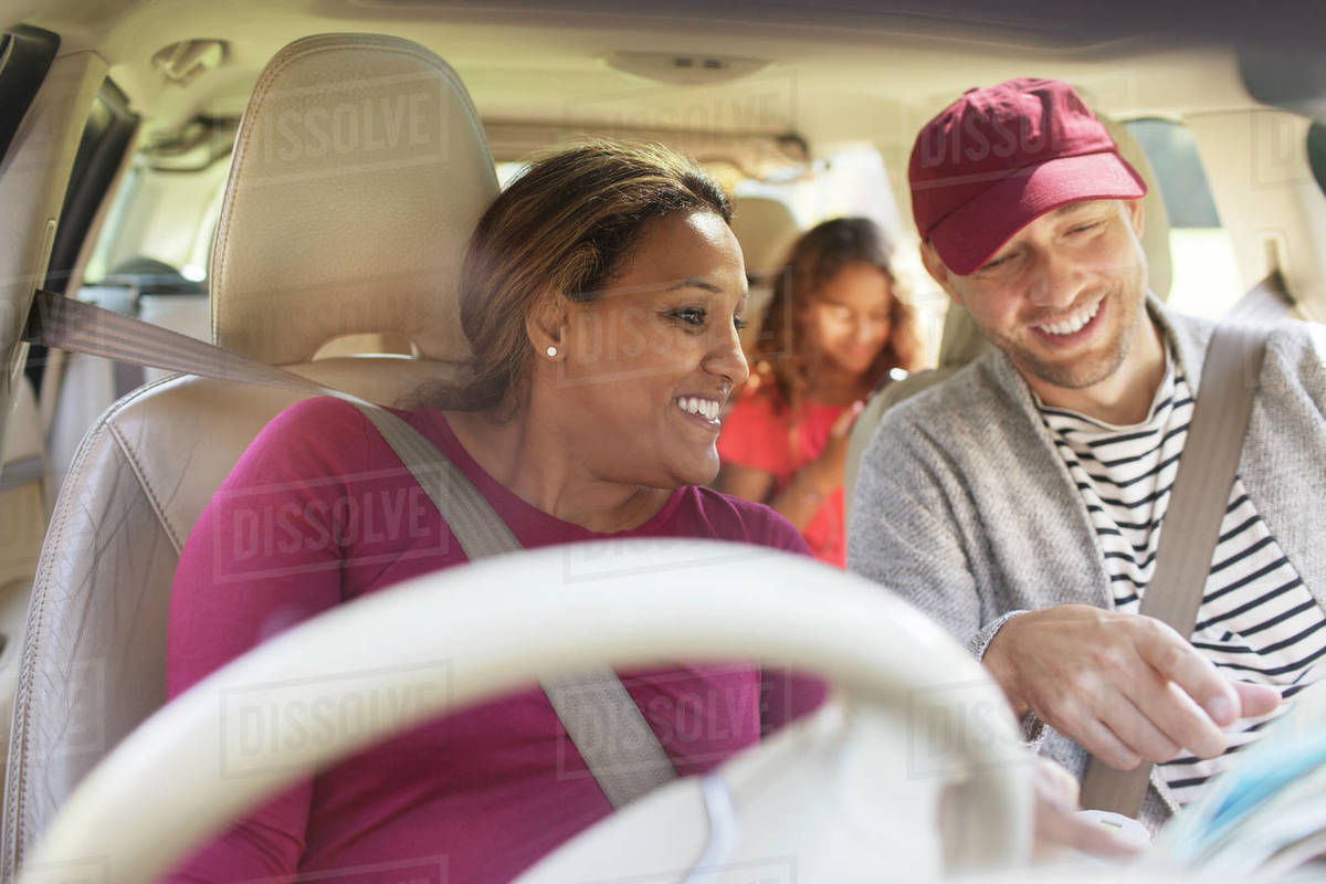 Couple on road trip, looking at map in car Royalty-free stock photo
