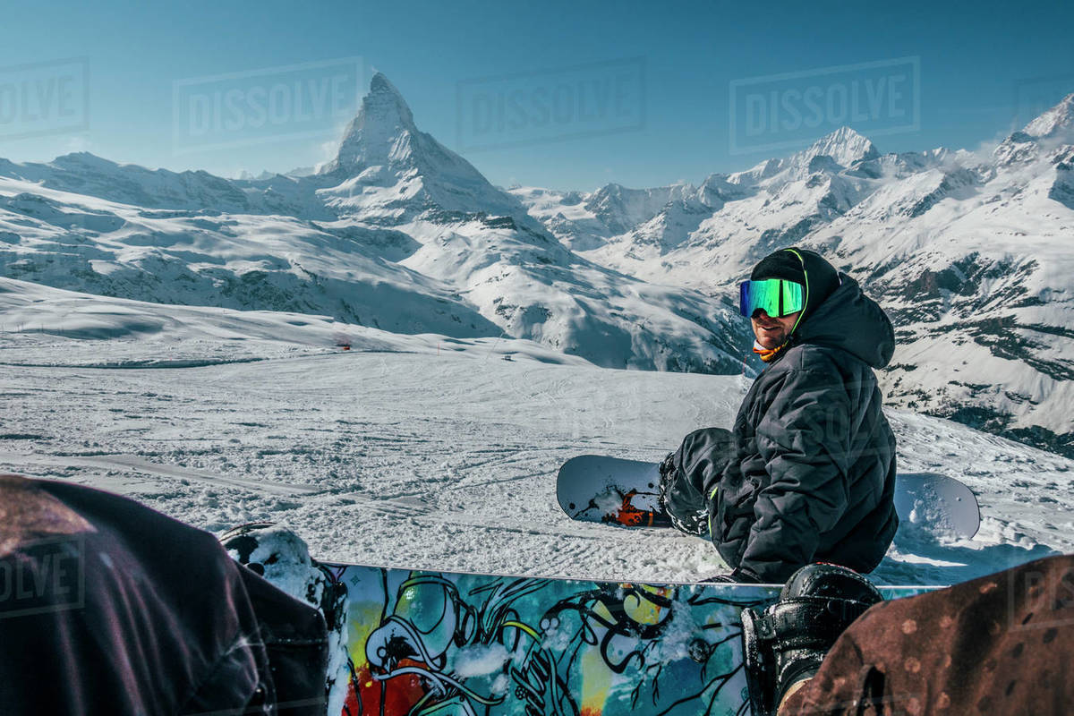 Personal perspective snowboarders on snowy ski slope, Zermatt, Switzerland Royalty-free stock photo
