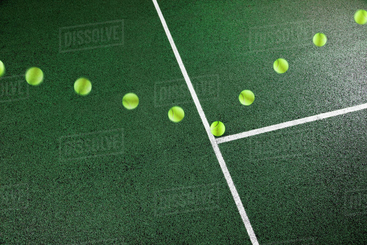 Multiple Exposure Of Tennis Ball Bouncing On Court Stock Photo
