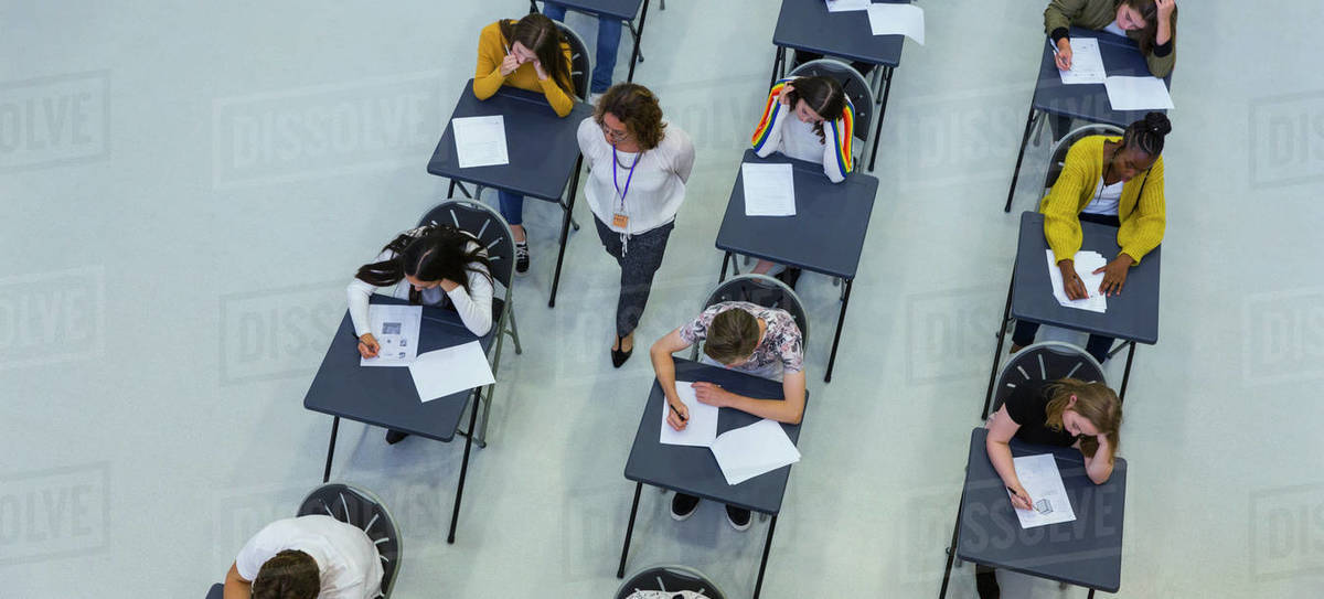 View from above high school teacher supervising students taking exam Royalty-free stock photo