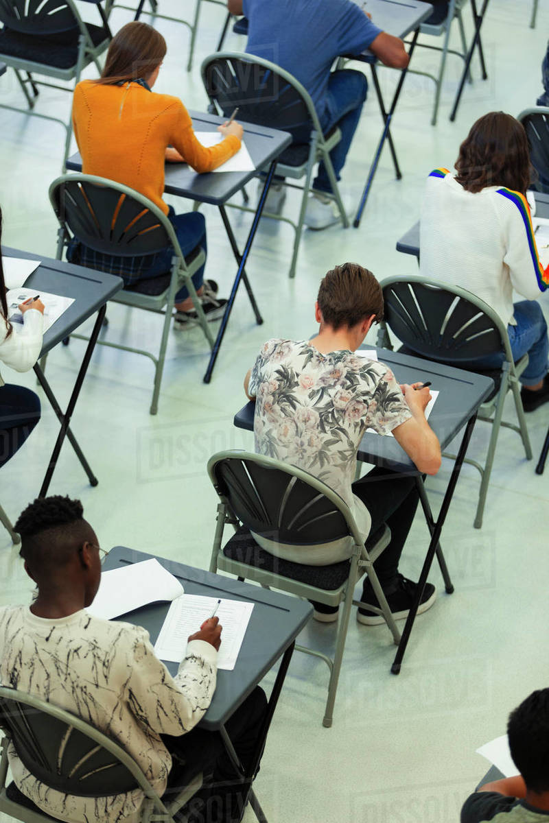 High school students taking exam at desks in classroom Royalty-free stock photo