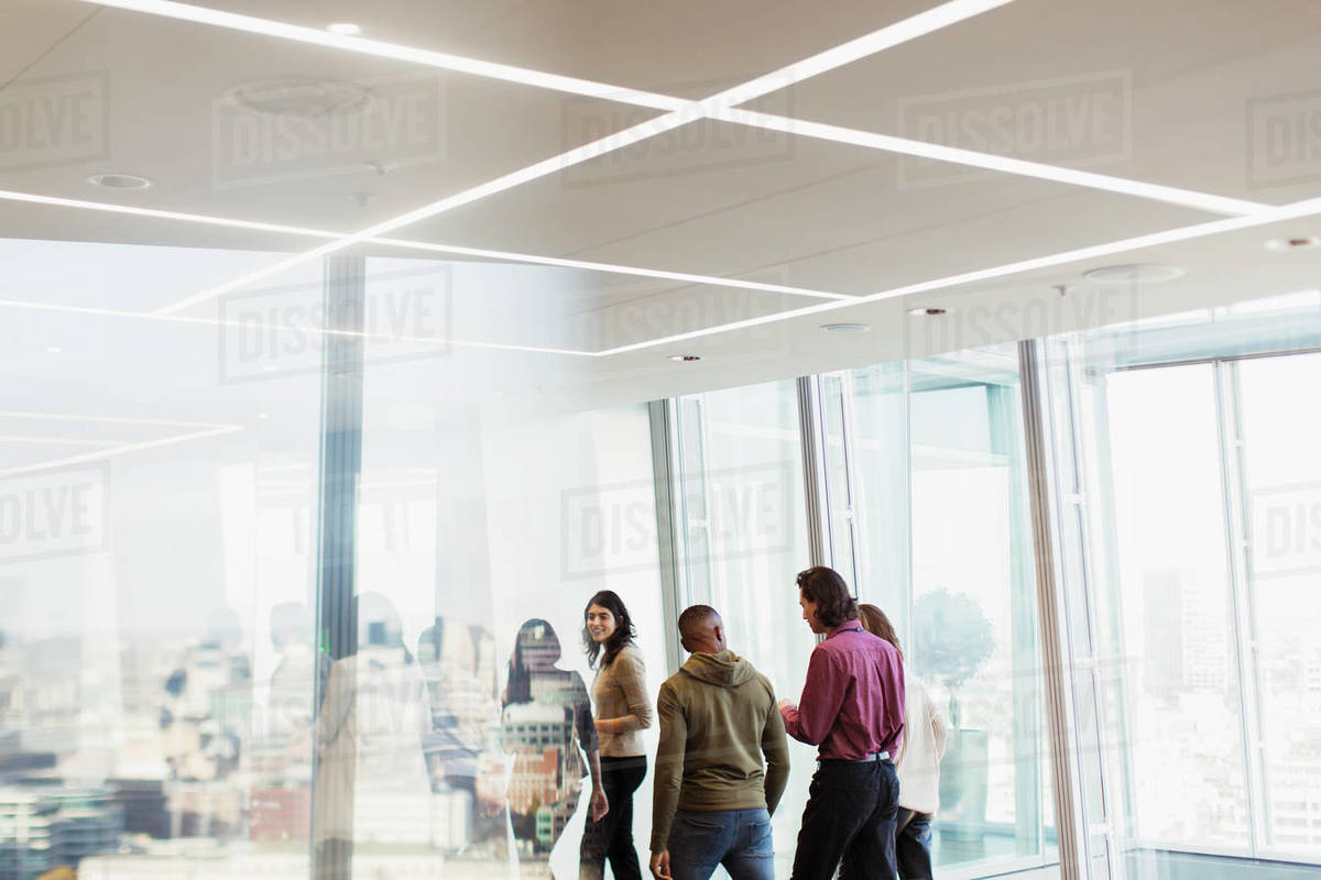 Business people talking in urban office Royalty-free stock photo