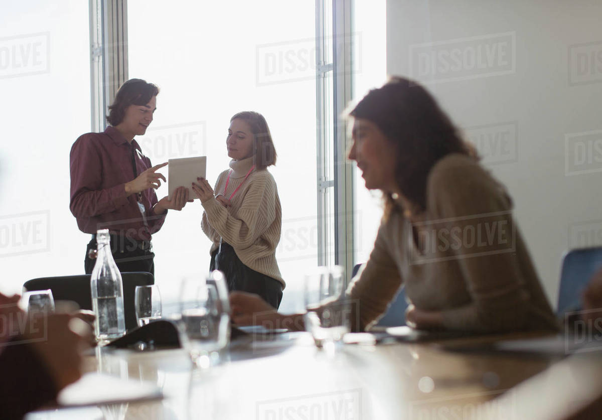 Business people with digital tablet talking at conference room meeting Royalty-free stock photo
