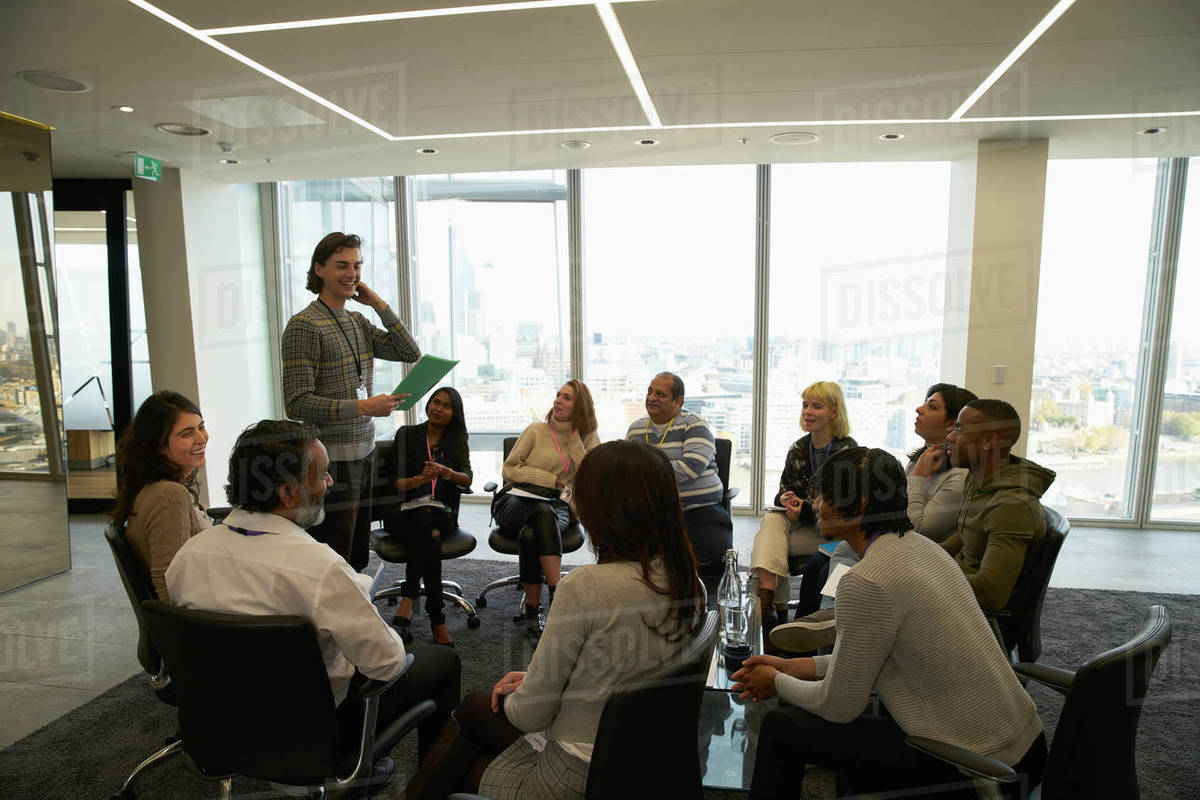 Business people meeting in circle in conference room Royalty-free stock photo