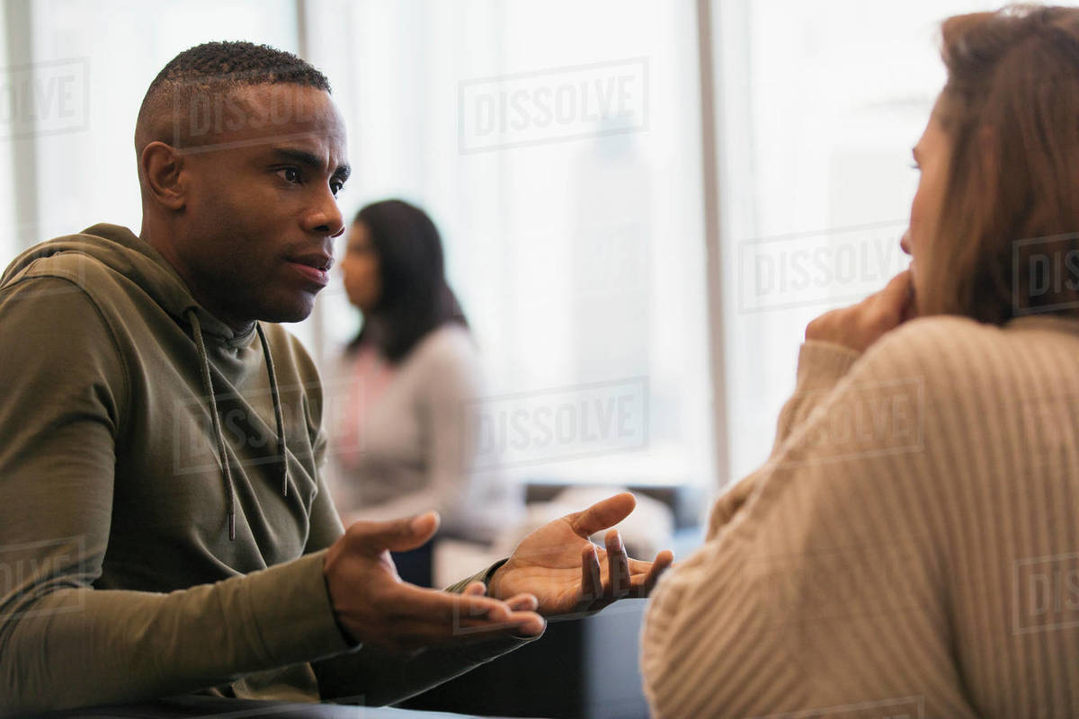 Businessman explaining to colleague in office Royalty-free stock photo