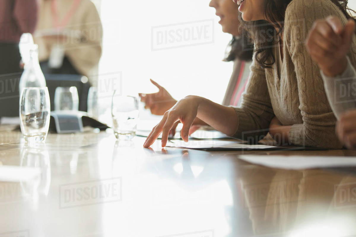 Business people with paperwork in sunny conference room meeting Royalty-free stock photo