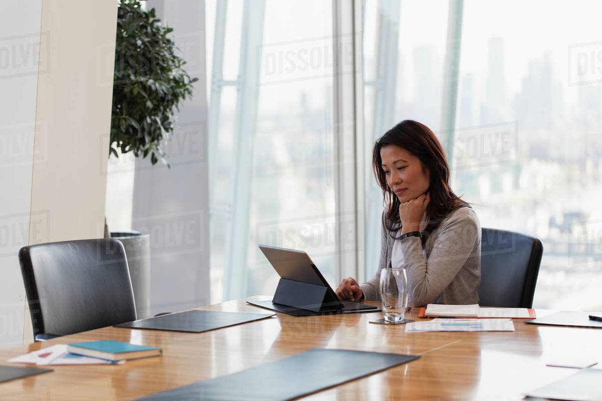 Dedicated businesswoman using digital tablet in conference room Royalty-free stock photo