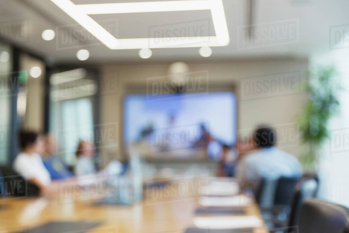 Defocused business people video conferencing in office meeting Royalty-free stock photo