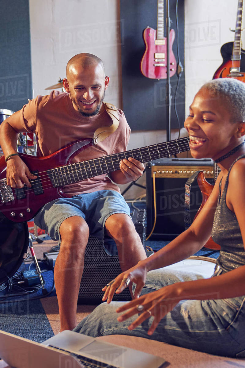 Musicians with laptop and electric guitar working in recording studio Royalty-free stock photo