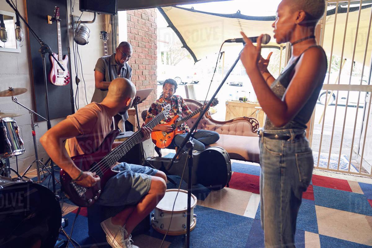 Musicians practicing in garage recording studio Royalty-free stock photo