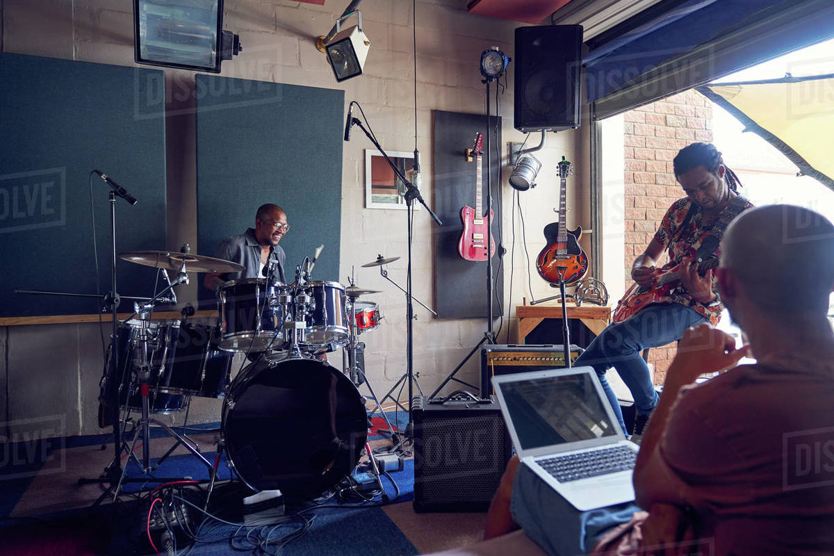 Musicians practicing in music recording studio Royalty-free stock photo