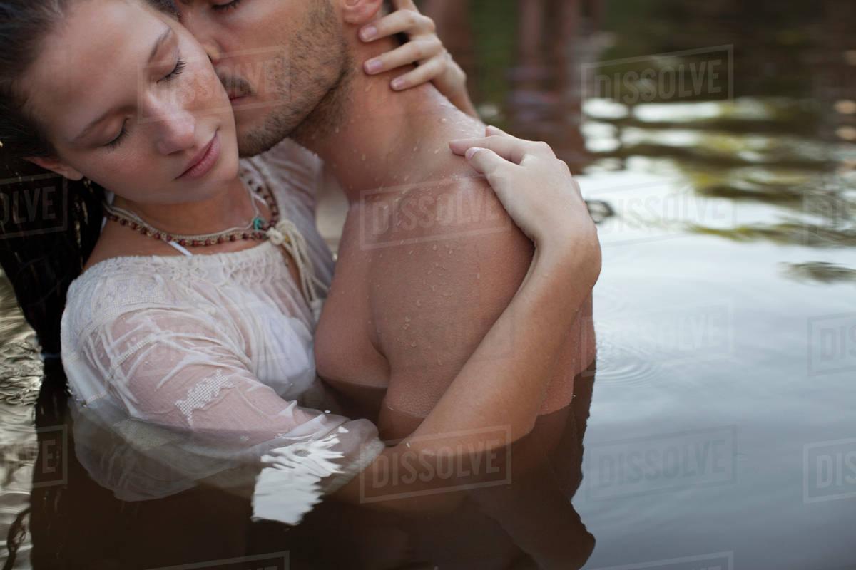 Sensual Couple Kissing In Lake