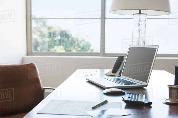 Laptop on desk in office Royalty-free stock photo