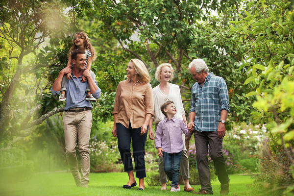 Multi-generation family walking together in park Royalty-free stock photo