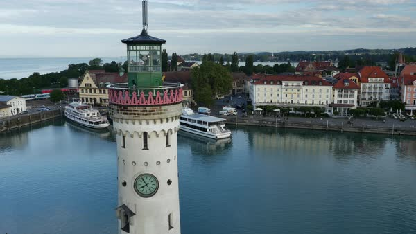 Aerial shot of a lighthouse of the port of Lindau Royalty-free stock video