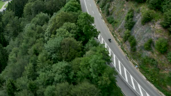 Aerial shot of a motorcyclist riding on a mountain road in Germany Royalty-free stock video
