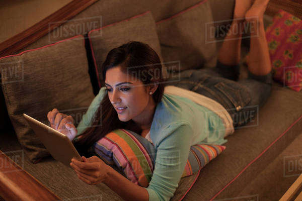 Woman relaxing with digital tablet at night Royalty-free stock photo