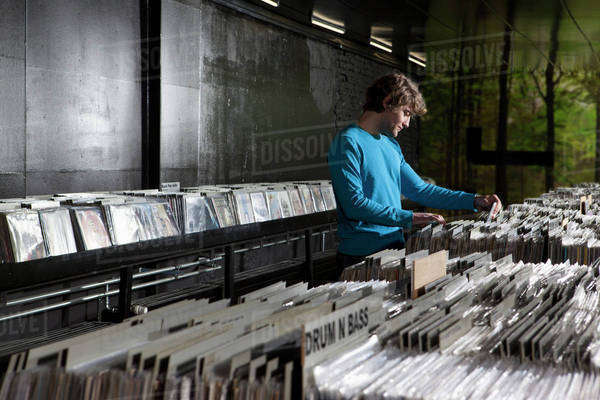 A young man searching through records in a record store Royalty-free stock photo