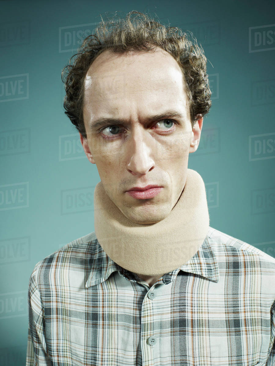 A Displeased Man Wearing Neck Brace And Looking Suiously To The Side