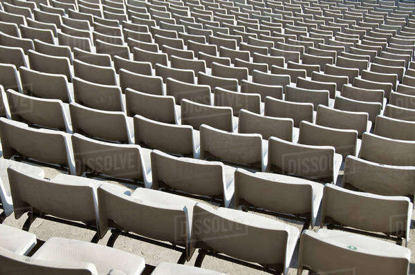 Rows of empty seats in sport stadium Royalty-free stock photo