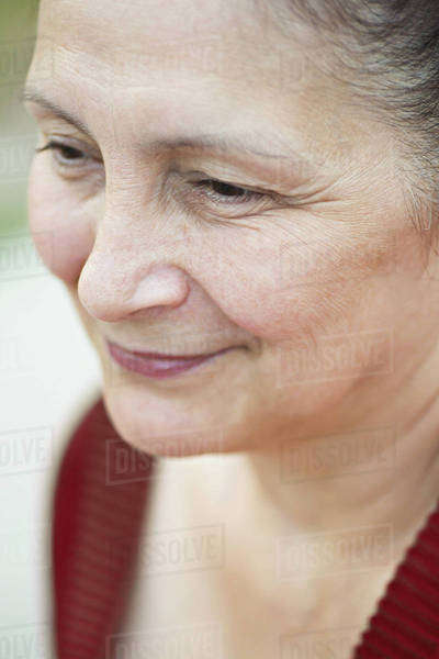 A mature woman looking away serenely Royalty-free stock photo