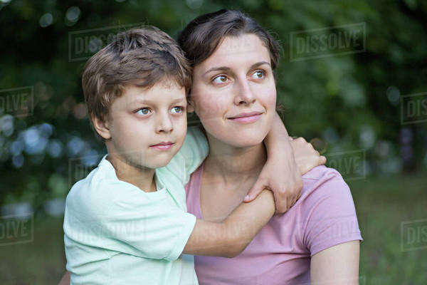 A serene mother and son looking away thoughtfully Royalty-free stock photo