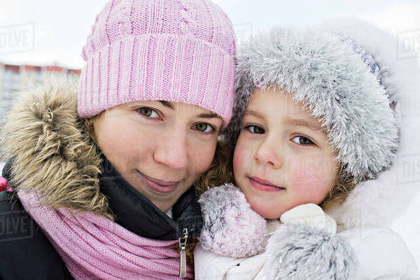 A mother and daughter in warm clothing outdoors in winter Royalty-free stock photo