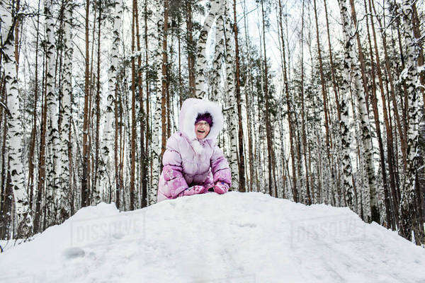 A young girl playing in the snow Royalty-free stock photo