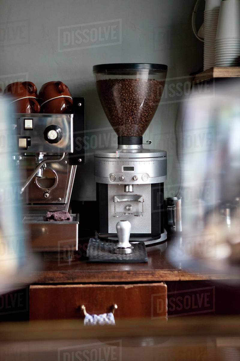 An Coffee Bean Grinder Next To Espresso Maker In A