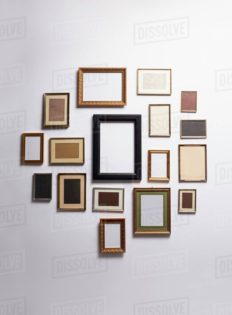 Various Empty Picture Frames Hanging On A Wall Royalty Free Stock Photo