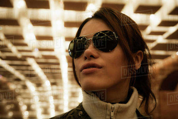 Close-up of mid adult woman wearing sunglasses in tunnel Royalty-free stock photo