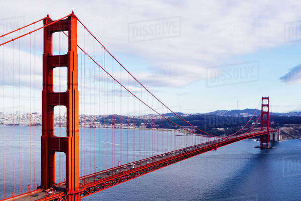 Golden Gate Bridge over San Francisco Bay against cloudy sky Royalty-free stock photo