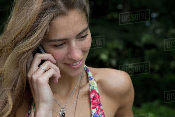 Young woman talking on phone, close-up Royalty-free stock photo
