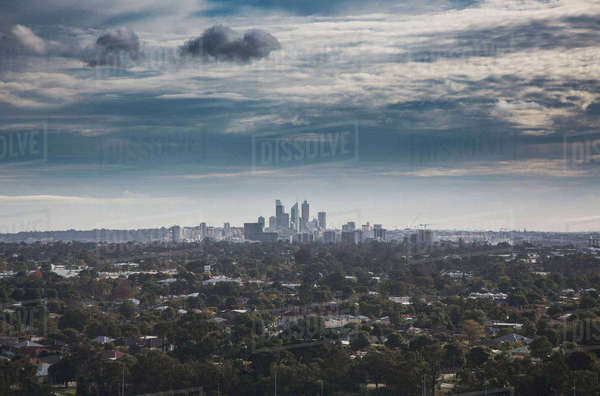 View of trees growing around city against cloudy sky, Perth, Western Australia, Australia Royalty-free stock photo