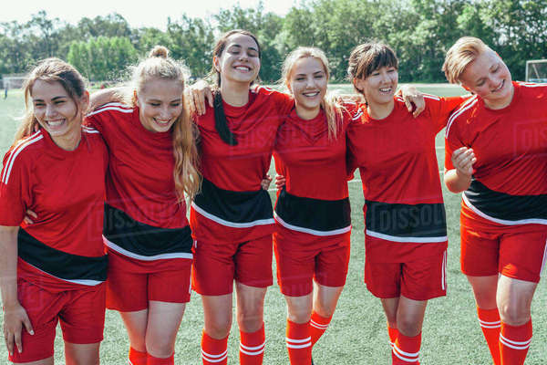 Cheerful soccer team standing on field Royalty-free stock photo