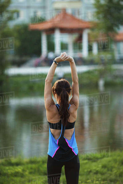 Rear view of woman stretching at park Royalty-free stock photo