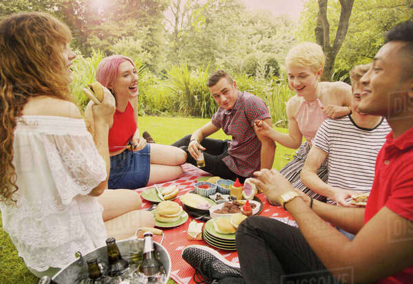 Cheerful friends having food during party at yard Royalty-free stock photo