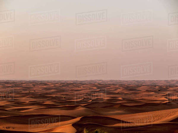 Scenic view of sand dunes in desert against clear sky during sunset, Dubai, United Arab Emirates Royalty-free stock photo